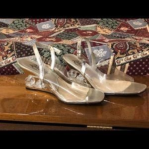 Size 7 M Silver and acrylic wedge slippers.